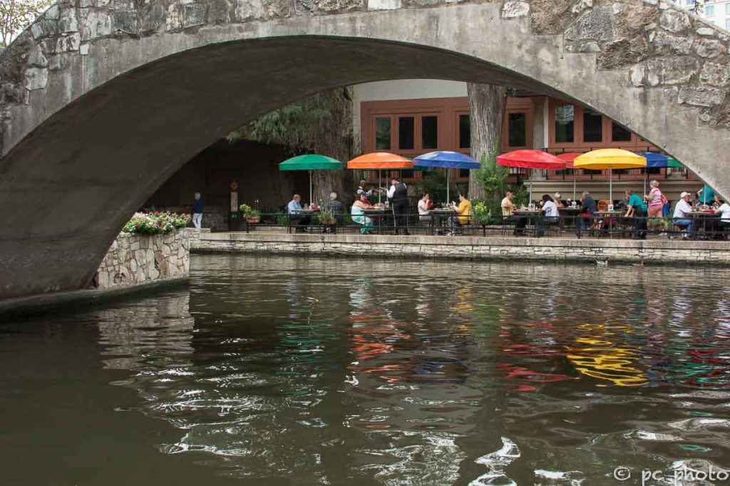 Foot-bridge over San Antonio Riverwalk colorful umbrellas-613-2