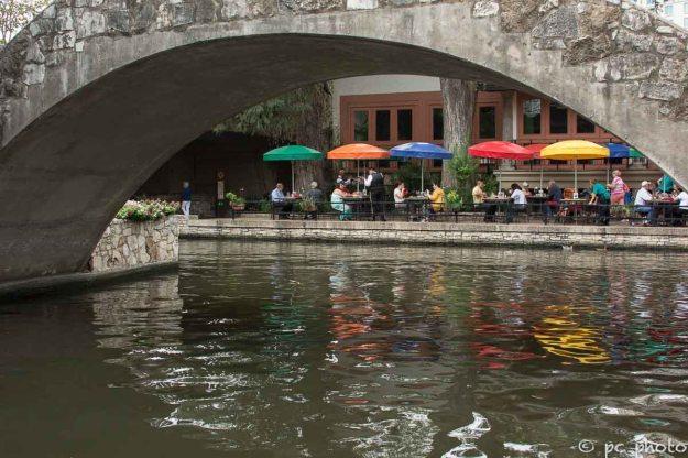 Foot-bridge over San Antonio Riverwalk colorful umbrellas-613-2