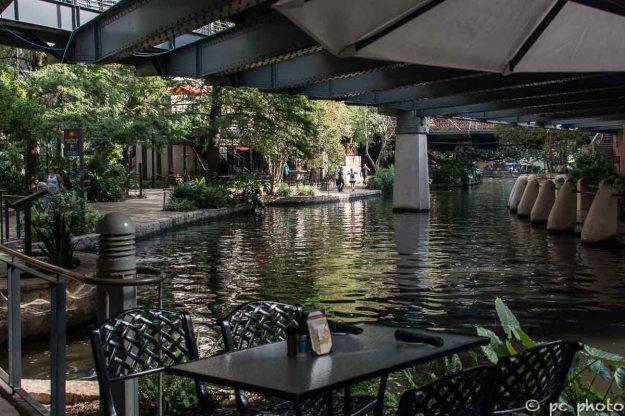 outdoor cafe under umbrella San Antonio Riverwalk colorful umbrellas-767-2