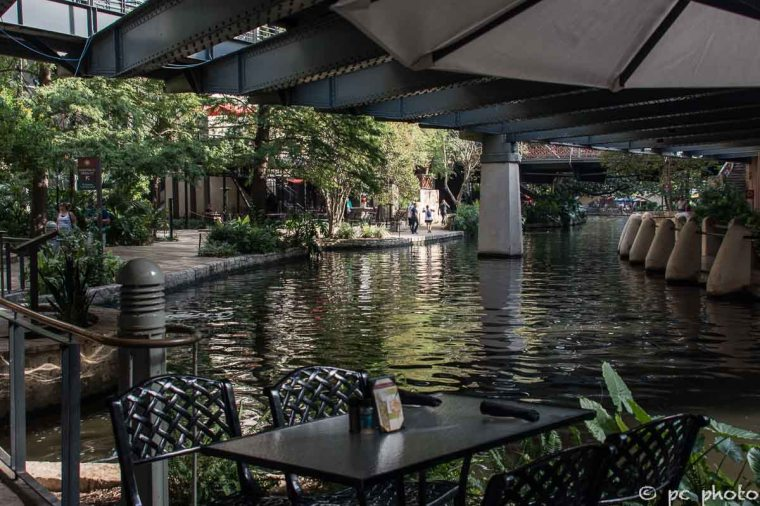 outdoor cafe under umbrella San Antonio Riverwalk colorful umbrellas-767-2