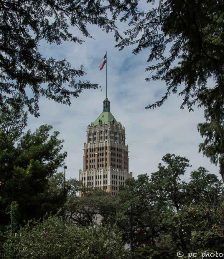 Texas flag high above the cityscape-635